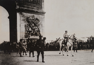 Street-level view of Marshal Philippe Pétain on a white horse passing under the Arc de Triomphe, Paris