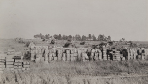 Stacks of ammunition boxes in a field, Soissons