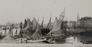 View of sailboats in port with the town in the background, Ostend