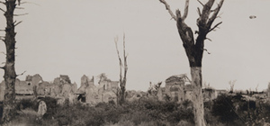 View of damaged stone buildings, burnt trees in the foreground, Nieuport [Nieuwpoort]