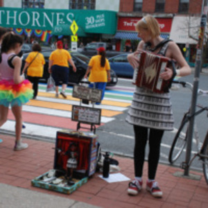 Accordionist at rainbow crosswalk