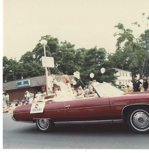 Peg Heckler riding in a convertible in the Town of Plainville 75th Anniversary Diamond Jubilee parade