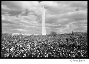 Sea of protesters with Washington Monument in background: Vietnam Moratorium march on Washington