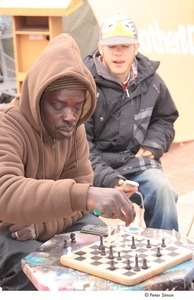 Occupy Baltimore: older man playing chess