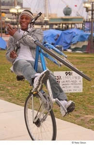 Occupy Baltimore: young man doing tricks on a bicycle