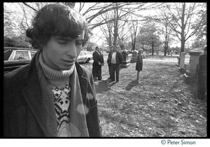 Stephen Davis (far left) at the funeral of Jack Kerouac, eyes cast downward in the cemetery