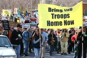 Beginning of the march, led by women holding a banner reading 'Bring the troops home now': rally and march against the Iraq War
