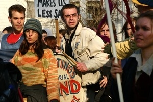 Anti-war marchers, one with a bass drum: rally and march against the Iraq War