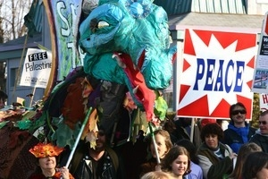 Anti-war marchers, dragon puppet, and 'Peace' signs: rally and march against the Iraq War