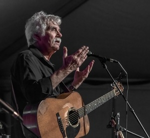 Tom Rush talking between songs during a performance at the Payomet Performing Arts Center