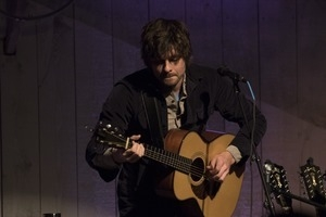 Matt Nakoa (acoustic guitar) performing in concert at the Payomet Performing Arts Center