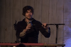 Matt Nakoa (keyboards) adjusting his microphone during a concert at the Payomet Performing Arts Center