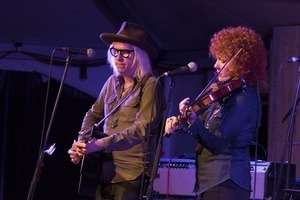 Chris Masterson (guitar) and Eleanor Whitmore (fiddle) performing onstage with Steve Earle and the Dukes at the Payomet Performing Arts Center