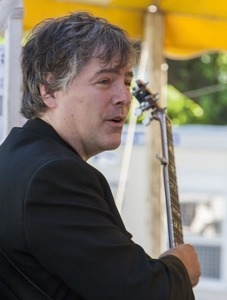 Bela Fleck with his banjo, on stage at the Clearwater Festival