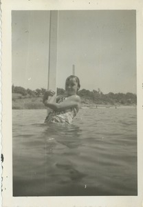 Sharon Kahn holding a pole in unidentified body of water