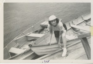 Bernice Kahn disembarking from a dinghy at Camp Annisquam