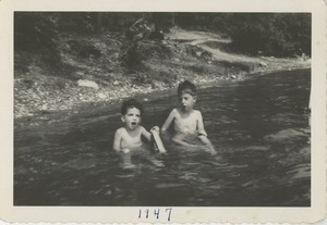 Paul and Joel Kahn in an unidentified body of water
