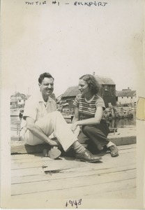 David and Bernice Kahn seated on a dock in Rockport