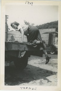 Bernice Kahn climbing into the back of a truck