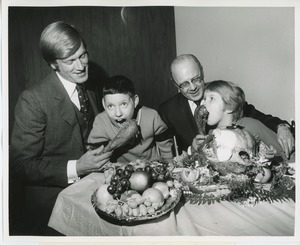 Actor Ken Hooper and Dr. Salvatore G. DiMichael with two young clients at Thanksgiving celebration