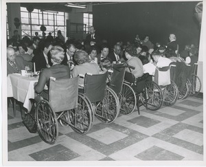 Clients in wheelchairs eating Thanksgiving dinner