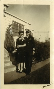 Commander Stanley W. Lipsiki in naval uniform and wife Sigrid Johnson Lipski outside a residence