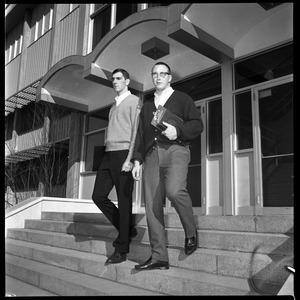 Greg Landry (quarterback, left) and Jim Mitchell (tackle), UMass Amherst football co-captains for 1967-1968, walking down the steps of Boyden Gymnasium
