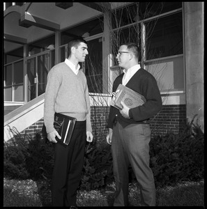Greg Landry (quarterback, left) and Jim Mitchell (tackle), UMass Amherst football co-captains for 1967-1968, outside Boyden Gymnasium