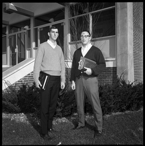 Greg Landry (quarterback, left) and Jim Mitchell (tackle), UMass Amherst football co-captains for 1967-1968, outside of Boyden Gymnasium