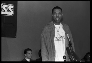 Marcus Camby standing at the microphone during a press conference