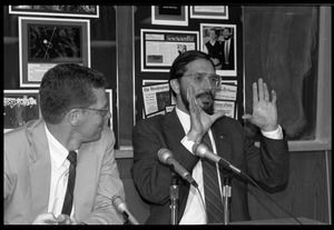 Russell A. Hulse (right, gesturing) and Joseph H. Taylor: seated at a microphone at a press conference at UMass Amherst following receipt of the Nobel Prize in Physics
