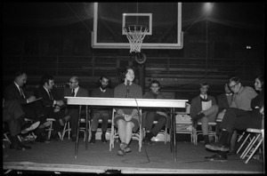 Helen Sullinger (student, UMass Amherst) makes a statement of students' viewpoint at open meeting with school administration, Curry Hicks Cage, regarding protests against war in Vietnam