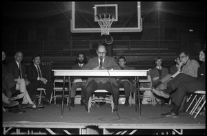 Joseph S. Marcus (engineering faculty and administrator, UMass Amherst) moderates at open meeting with school administration, Curry Hicks Cage, regarding protests against war in Vietnam