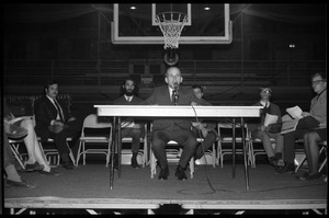 Mark Noffsinger (Associate Dean of Students, UMass Amherst) makes opening remarks at open meeting with school administration, Curry Hicks Cage, regarding protests against war in Vietnam