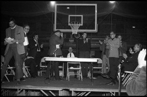 Applause given for speaker at the open meeting with school administration, Curry Hicks Cage, regarding protests against war in Vietnam
