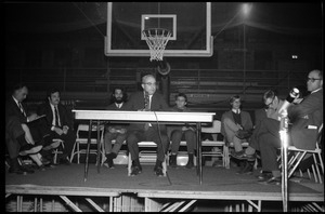 John W. Lederle (President, UMass Amherst) responds to questions at open meeting with school administration, Curry Hicks Cage, regarding protests against war in Vietnam