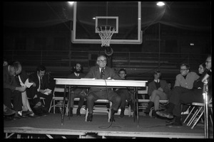 Oswald Tippo (Provost, UMass Amherst) speaks at open meeting with school administration, Curry Hicks Cage, regarding protests against war in Vietnam