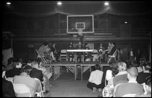 Mark Noffsinger (Associate Dean of Students, UMass Amherst) speaking at open meeting with school administration, Curry Hicks Cage, regarding protests against war in Vietnam