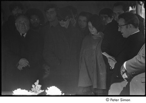 Jack Kerouac's funeral: mourners gathered around casket, Father Armand Morrissette (right)