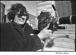 Jack Kerouac's funeral: Gregory Corso setting up film camera outside of church