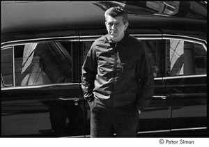 Jack Kerouac's funeral: man standing in front of a car