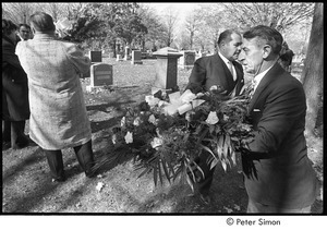 Jack Kerouac's funeral: man carrying wreath at the cemetery