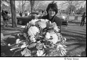Jack Kerouac's funeral: Gregory Corso holding flowers at the cemetery, Allen Ginsberg filming in background