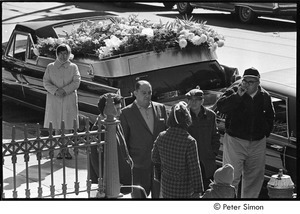 Jack Kerouac's funeral: men and women standing by hearse