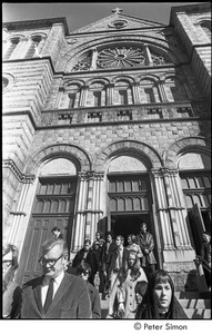 Jack Kerouac's funeral: mourners leaving church, Peter Orlovsky (left, partially out of frame) and John Clellon Holmes