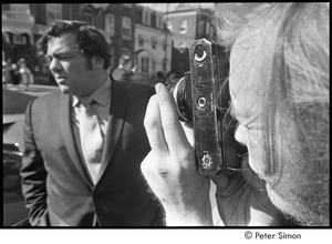 Jack Kerouac's funeral: Jeff Alberston photographing Jimmy Breslin outside church