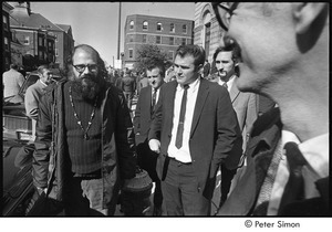 Jack Kerouac's funeral: outside church, Allen Ginsberg (left) with other mourners