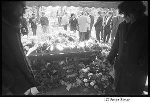 Jack Kerouac's funeral: view of casket at the cemetery, Allen Ginsberg (left) and Gregory Corso (right) in foreground