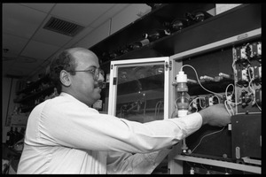 Colleague of Louis Carpino working in the lab