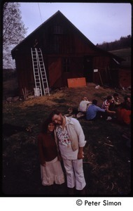 Couple in front of the barn, Tree Frog Farm commune